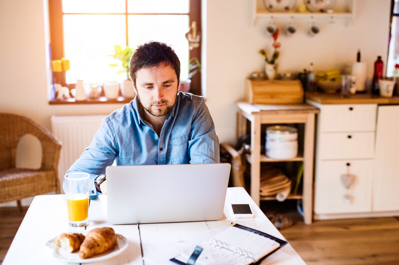 Male working from home in kitchen environment